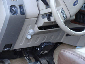 The interior of a vehicle with a Ravelco plug securely mounted to thwart car thieves every time.